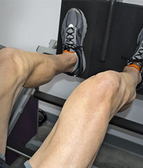 CLose Up of client Mick doing Leg Press