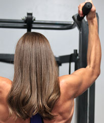 Close-up of client Sandi's Bicep and Flexors while doing a pull-up